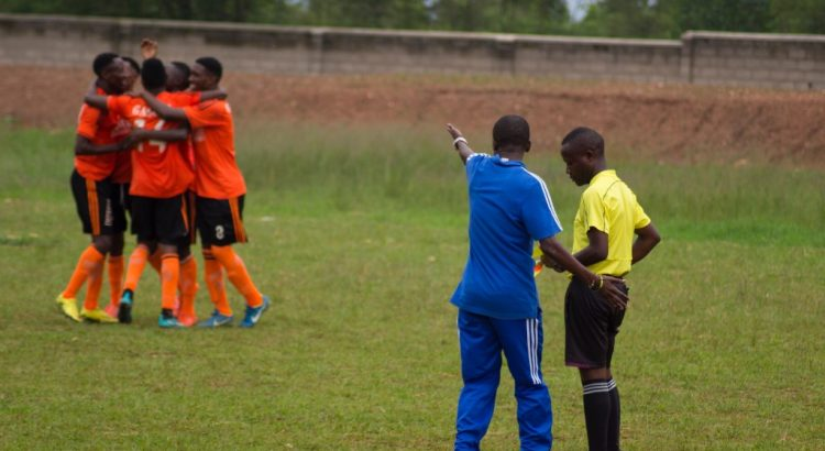 Soccer coach complaining to referee