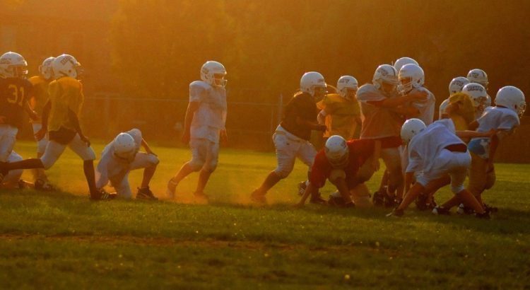 Youth Football Practice at Sunset
